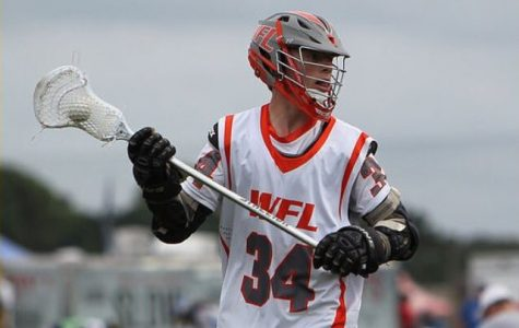 Junior Jeremy Handman, looking for an open man during a lacrosse game.