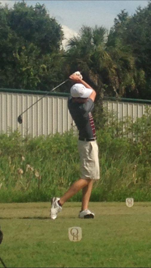 Senior Ethan Shuster taking a swing at practice.