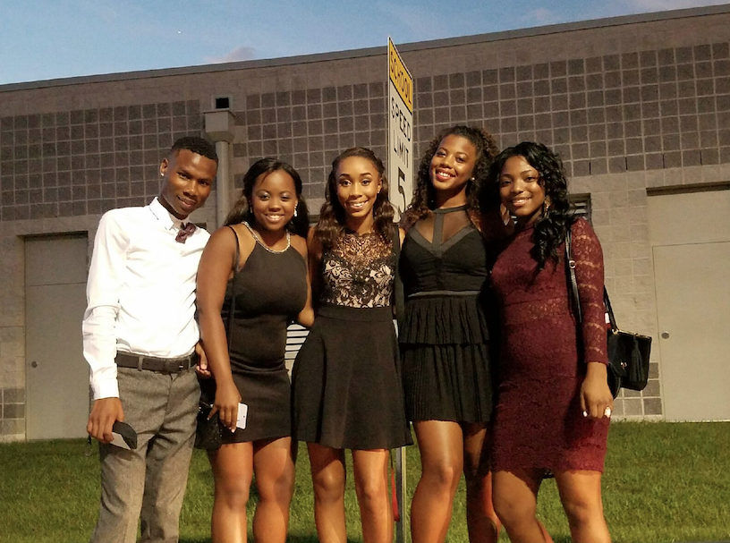 Keeana Harris and friends Jovawn, Tyanah, Siara, and Amari pose for a picture before Homecoming dance.