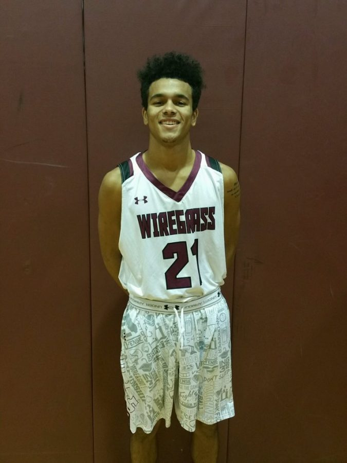 Devin Wilson smiling in his uniform. (Photo taken by TJ Forgas)
