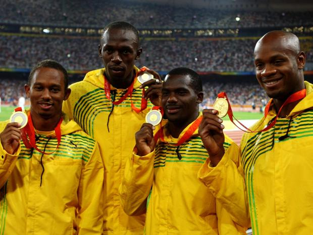 The Jamaica 4x100M winning team. From left to right, Michael Frater, Usain Bolt, Nesta Carter, and Asafa Powell