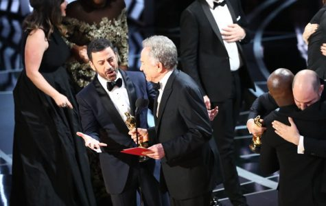 Jimmy Kimmel, left, and Warren Beatty onstage at the Academy Awards in Los Angeles on Sunday night. Credit Patrick T. Fallon