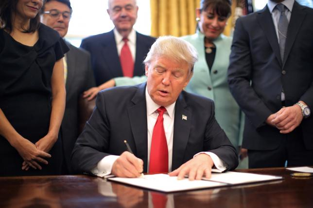 U.S. President Donald Trump signing the executive order to ban the immigration to America from seven countries