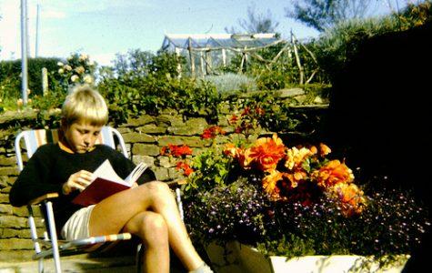 Boy reading in his garden. AndyRobertsPhotos (2013).