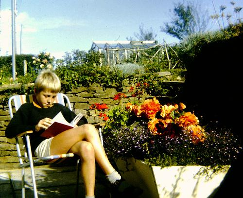 Boy reading in his garden. AndyRobertsPhotos (2013).