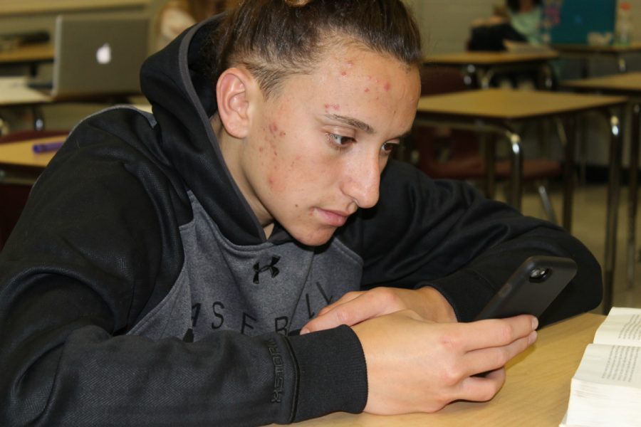 TJ Forgas on his phone during class.