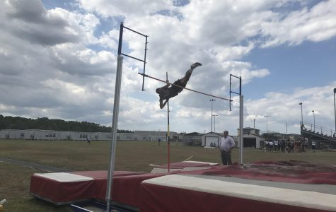 Senior Will Lovelace clears nine feet.
