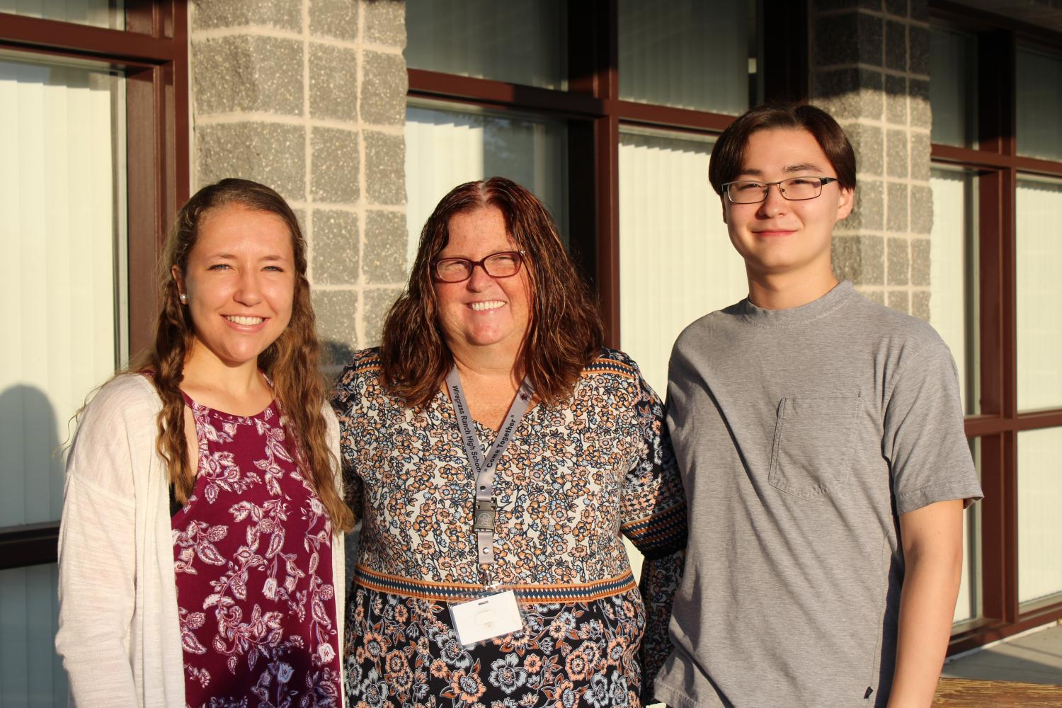 Two of the semi-finalists from WRHS, Emily Leonard (12) and Taylor Douglas (12), with Mrs. White.