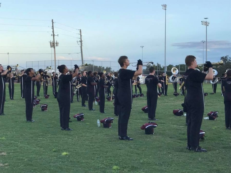 The band during music warm-up before competing