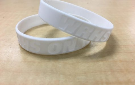 Bulls on Track wrist band that were given out during the first quarter to students who were on track.