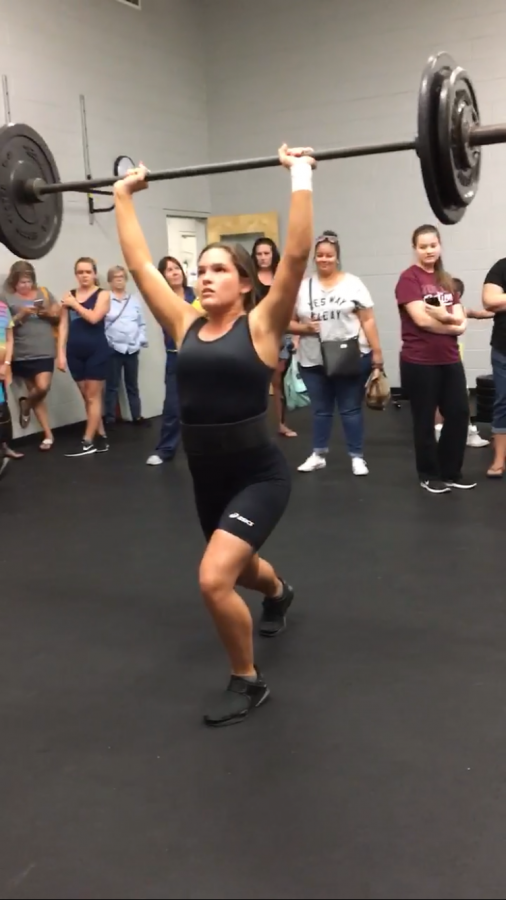 Emily+Beazley+finishes+a+successful+clean+and+jerk+lift+of+115lbs.+