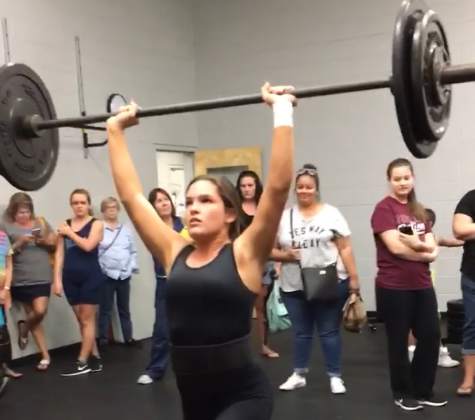 Lady Bulls' weightlifting team powers through competition