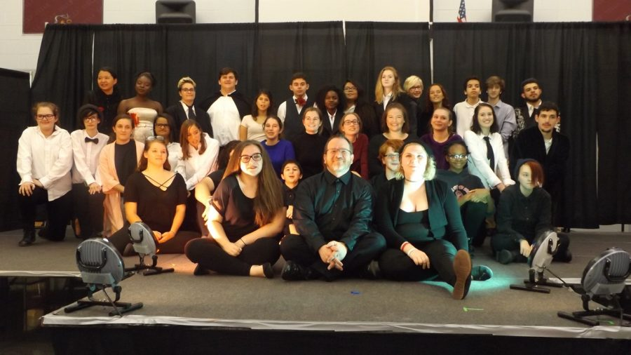 The cast, crew, and director of the performance.
