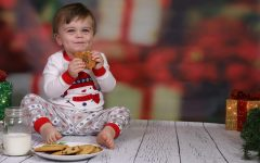 Students photograph staff children for the holidays