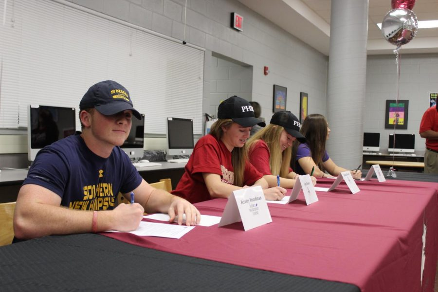 All the athletes signing to their future school.