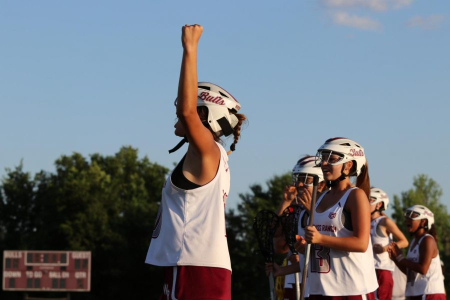 Wiregrass girls lacrosse celebrating a goal.