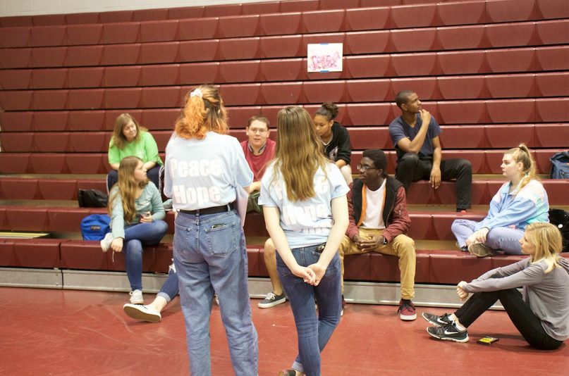 A group of students communicating at Unity Day