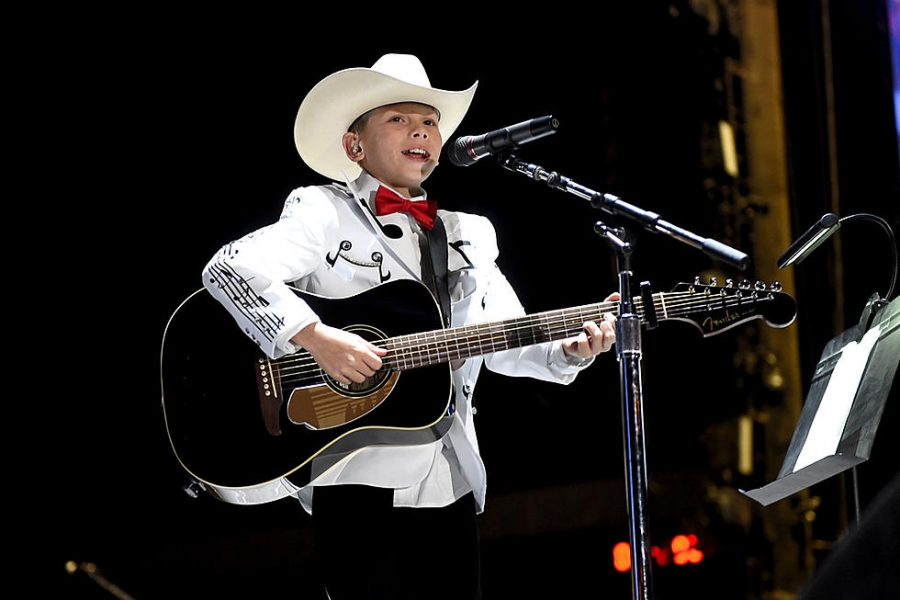 Mason Ramsey performing at the stagecoach festival.