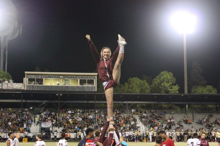 Molly Doyle as a flyer at a Bulls football game