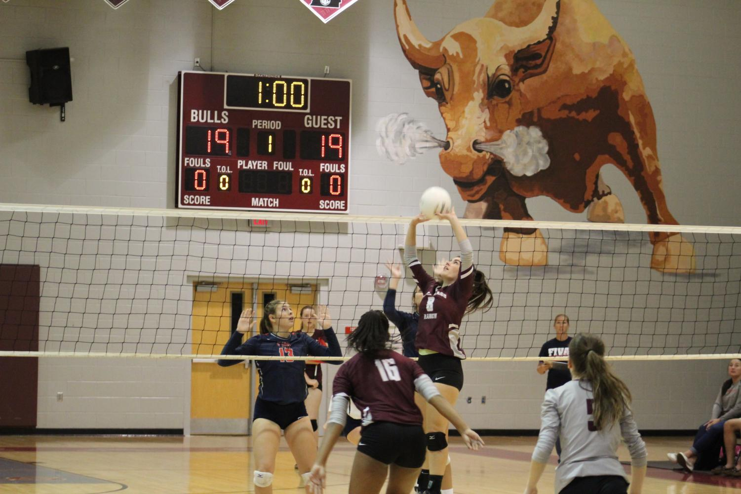 Senior Alexis Pryor (8) setting up a potential spike for Sophomore Zoi Evans (16)
