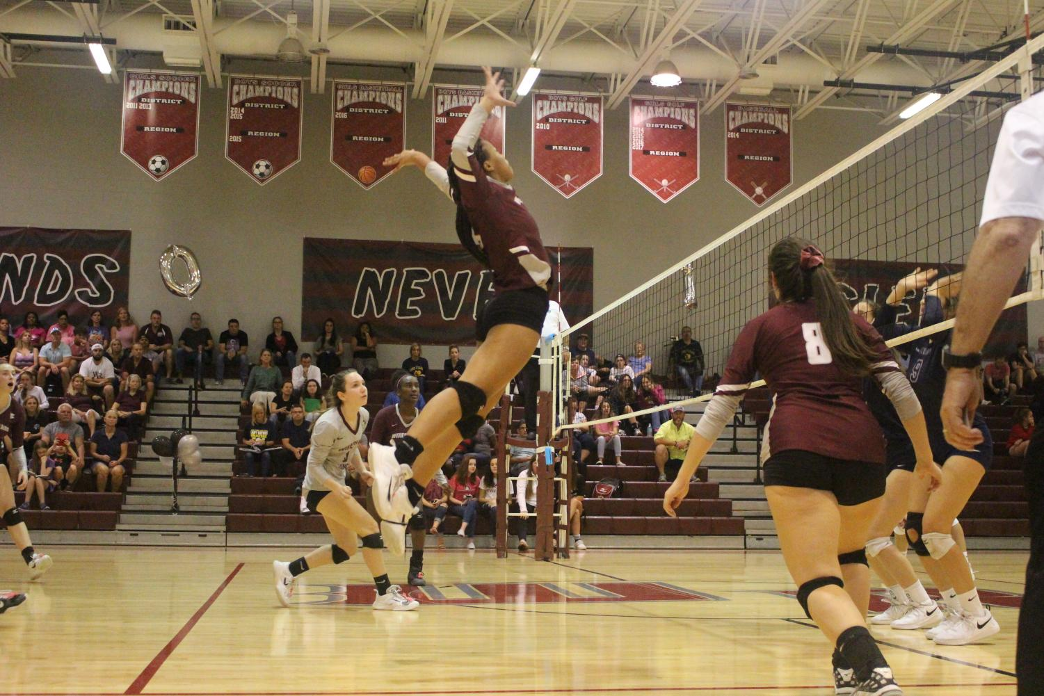 Junior Amiyah Martin attempts a kill.