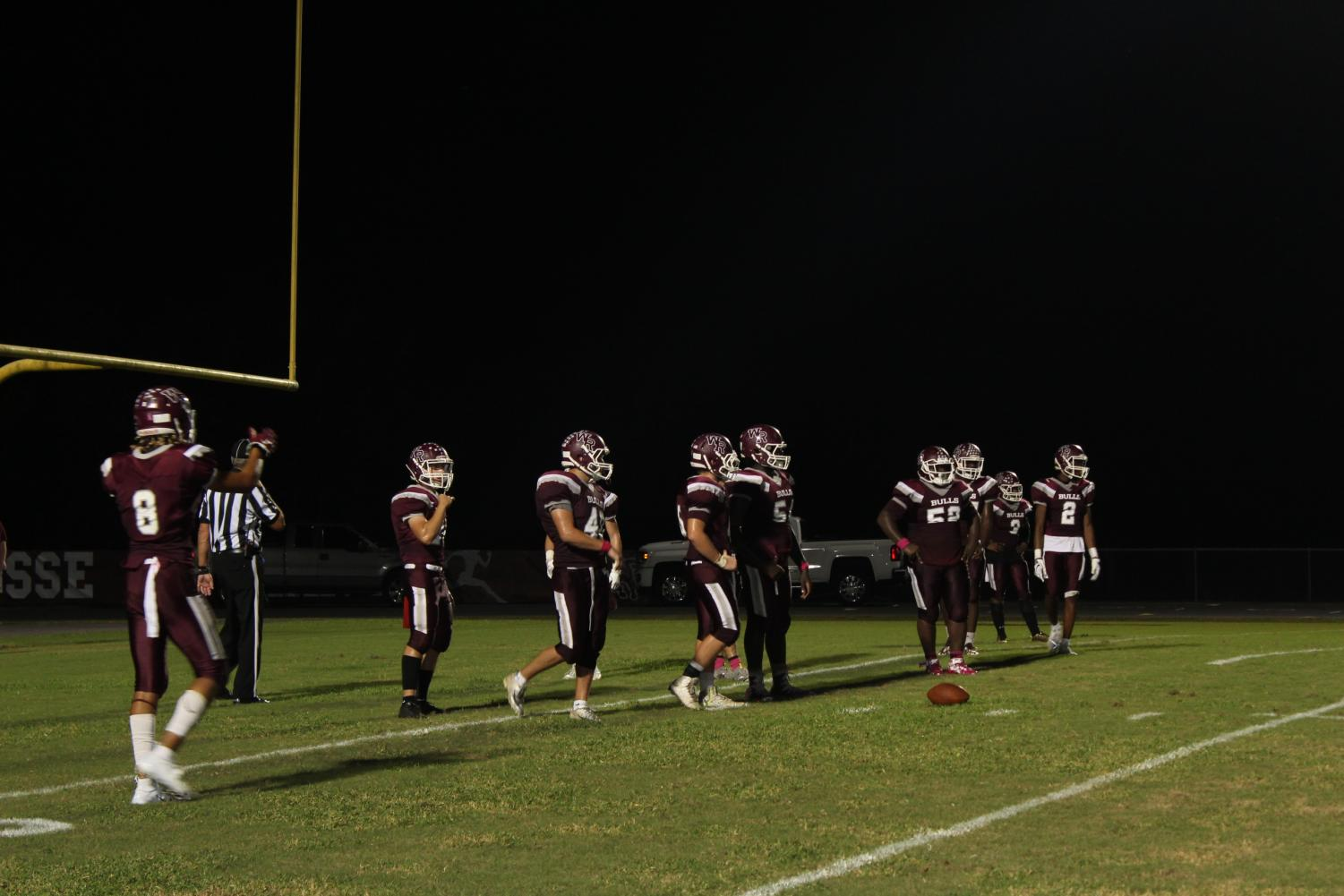The Wiregrass Ranch Bulls gather at the line of scrimmage to make a play.