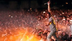 Travis Scott performing at a previous concert before the Tampa location concert was cancelled.