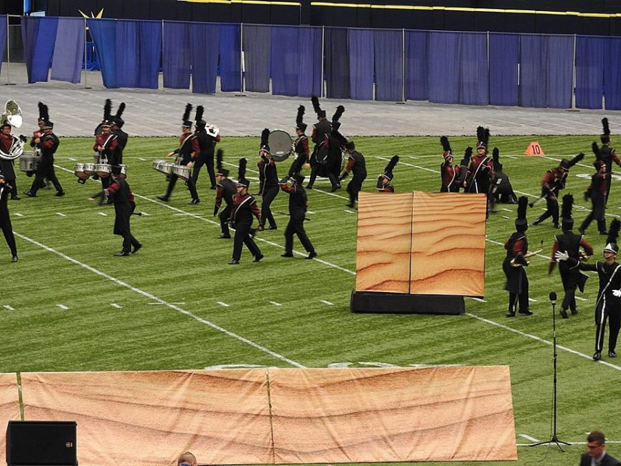 Band members performing their hearts out  in their last run of the season