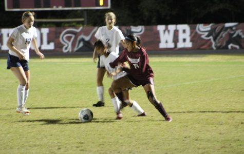 Senior forward Kat Llanos fights for the ball on offense.
