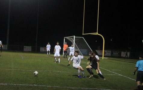 Sophomore Adam Mihalek fighting for the ball.