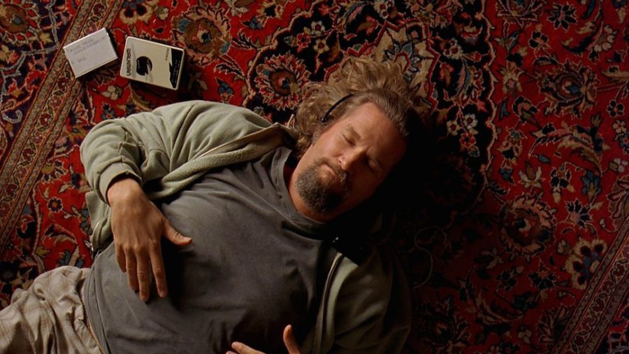 The Dude relaxes on his new rug.