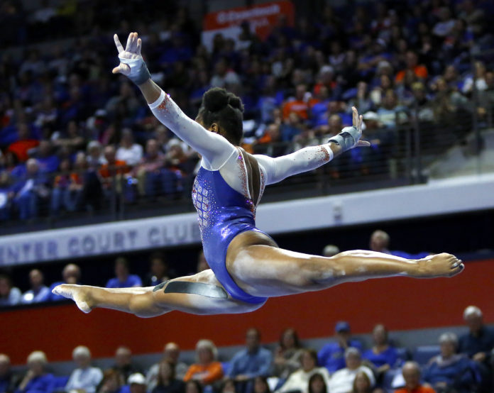 University of Florida gymnast Alicia Boren competes on the beam during the opening meet of the season against Missouri at the Exactech Arena in Gainesville Jan 11, 2019. The Gators beat the Tigers.   [Brad McClenny/The Gainesville Sun]
