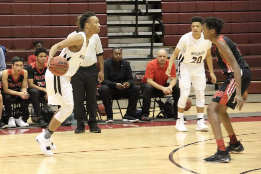 Senior Forward Tyreek Green begins a drive towards the basket in an attempt to score.