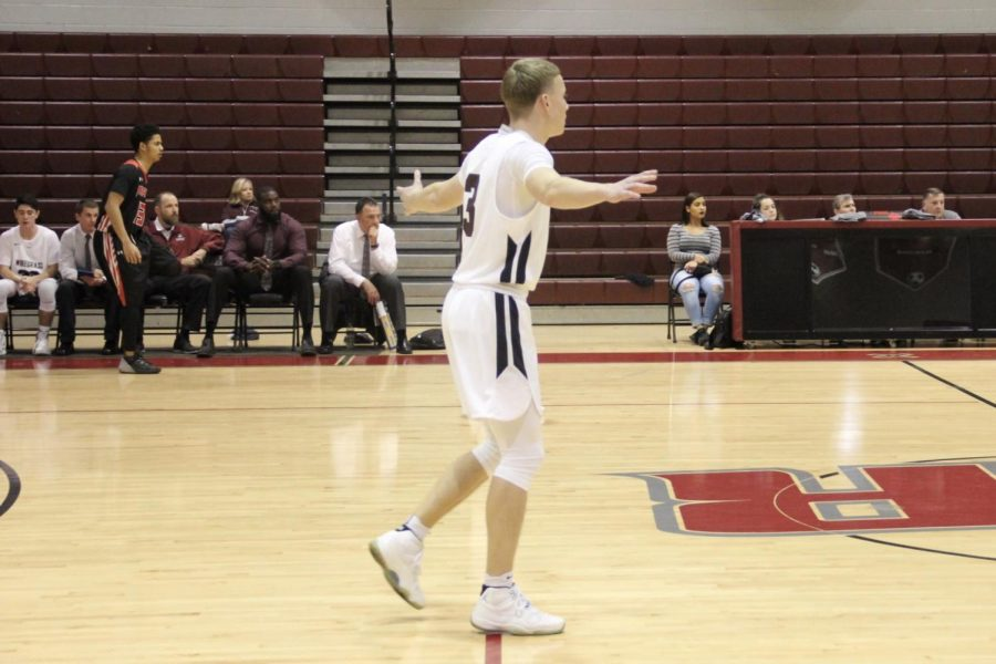 Junior Guard Lucas Pelt defends in the half court set for the Bulls
