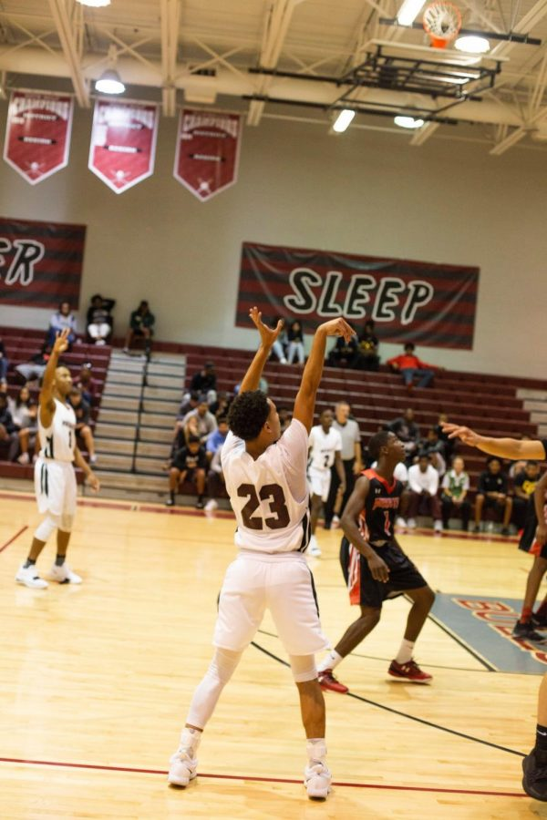 Elijah Howell shoots a contested three pointer during one of the Bulls' scoring runs.