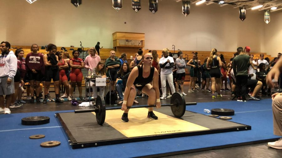 Maridith Baker performing a clean and jerk.