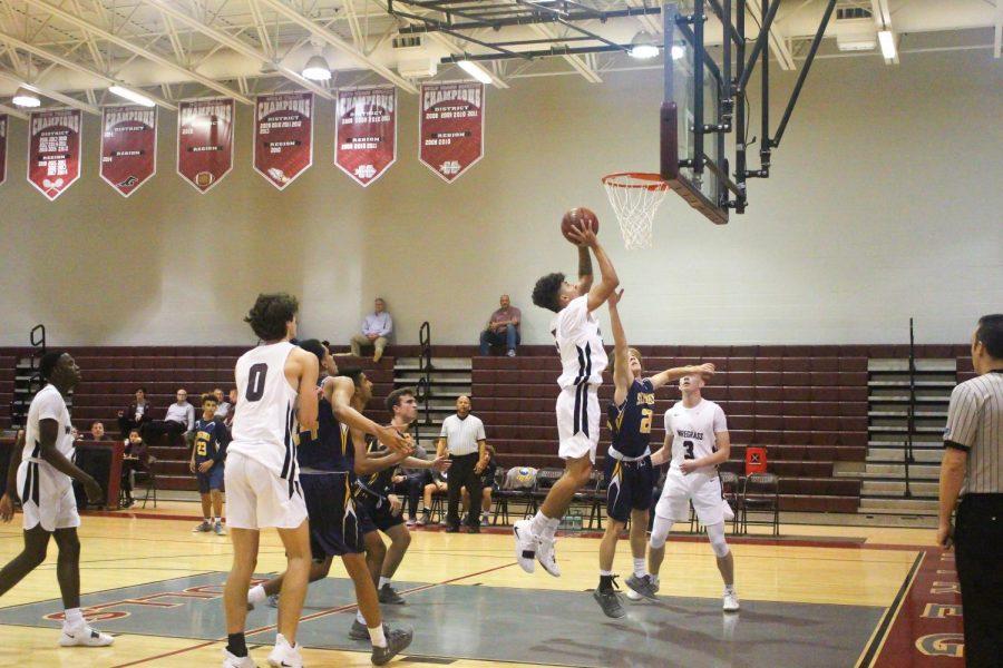 Junior Logan Ghoumari going up for a put-back rebound