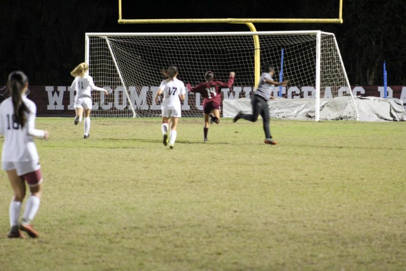 Senior Katherine Llanos scores the game winning goal.