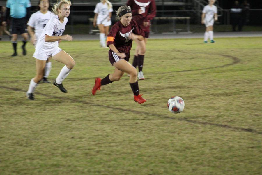 Senior Ysa Novak clears the ball out of the Bull's defensive zone.