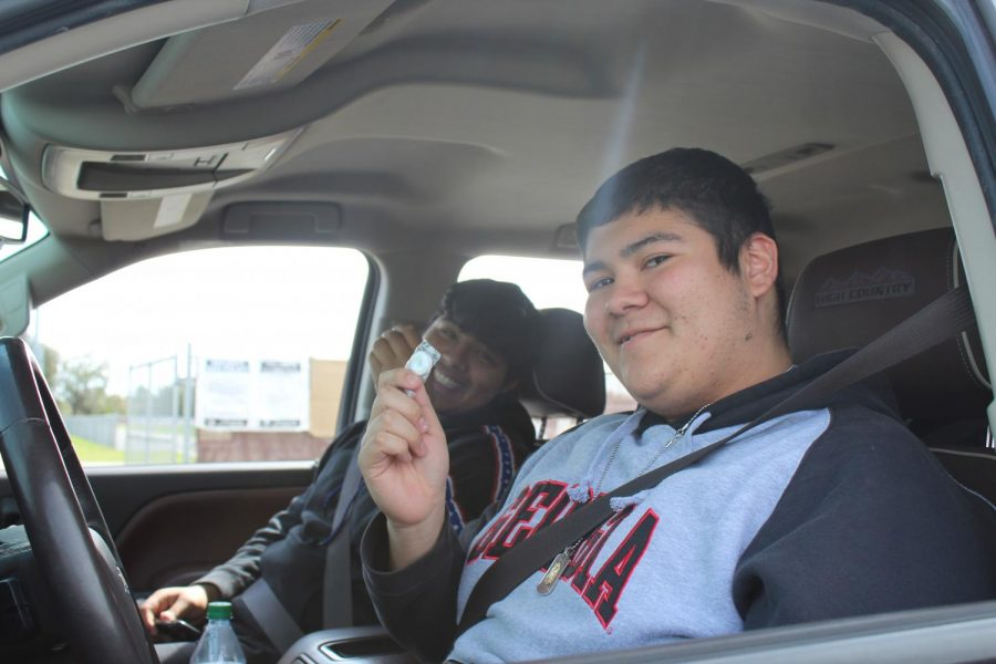 Junior Andres Jiminez and his passenger Barit Dhungana both earned their candy by securing their seat belts.