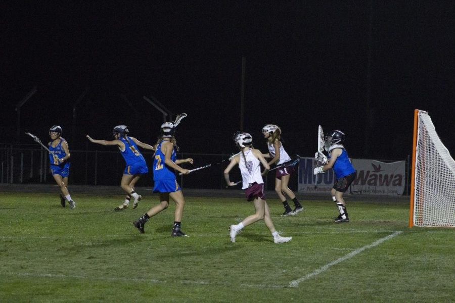 Wiregrass players waiting for a pass at the crease.