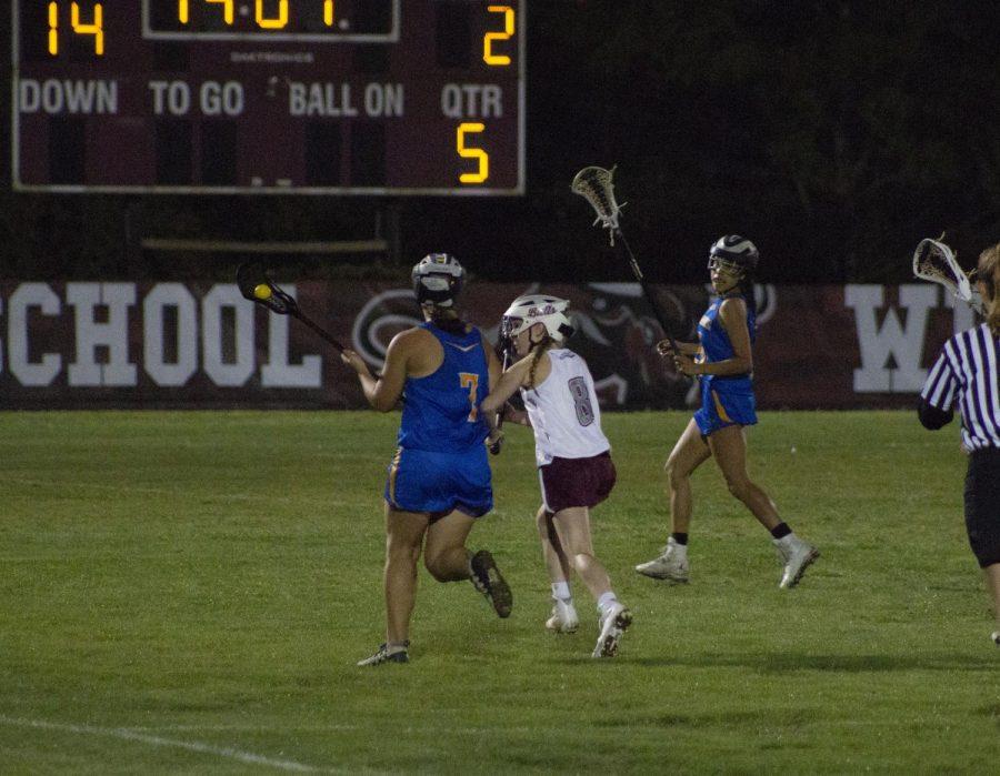 Marisa Taylor (8) defending the ball.