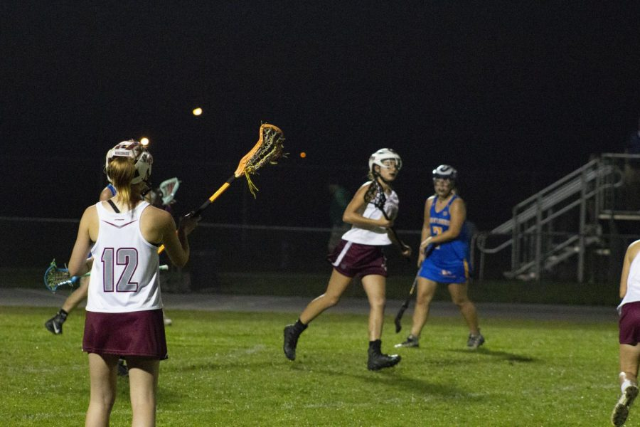 Simone Billington (12) communicating with teammate Jenna Kiley (10) during the game.