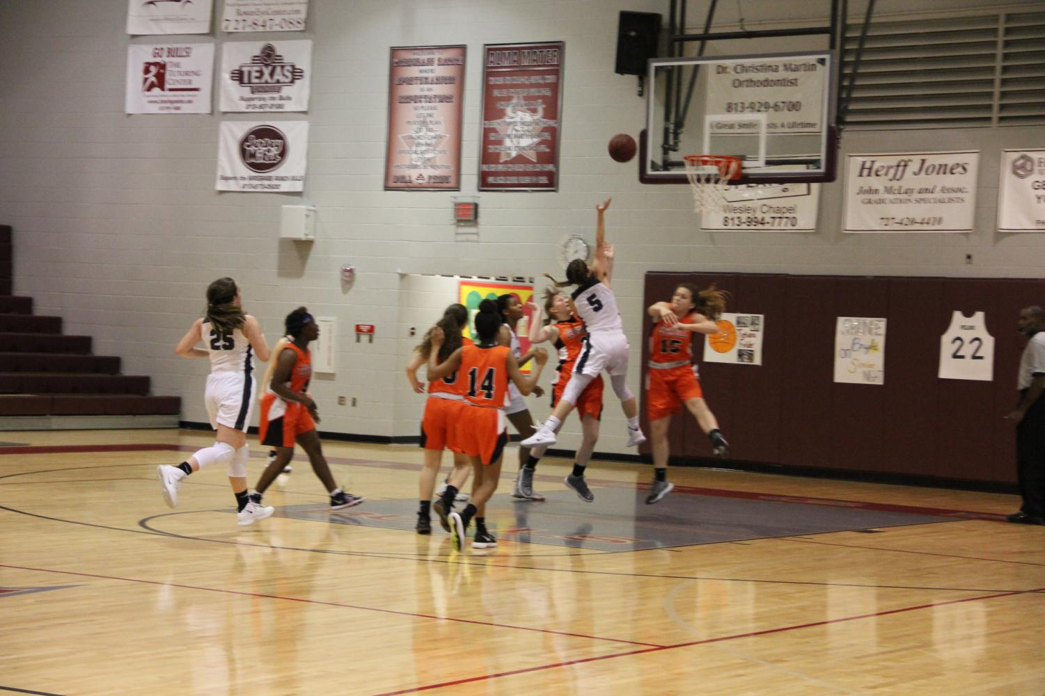 Junior Madison Gant drives to the basket looking to score.