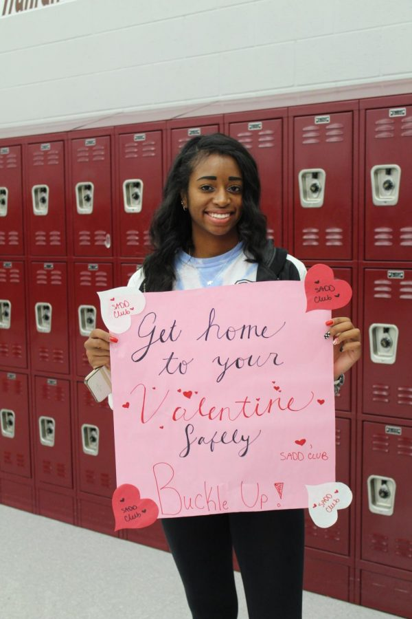 S.A.D.D member, Jaelyn Kirkland, is proud to support the club with a poster that states