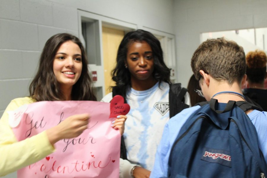 S.A.D.D presents BOTB with pieces of candy for students on Valentine's day.