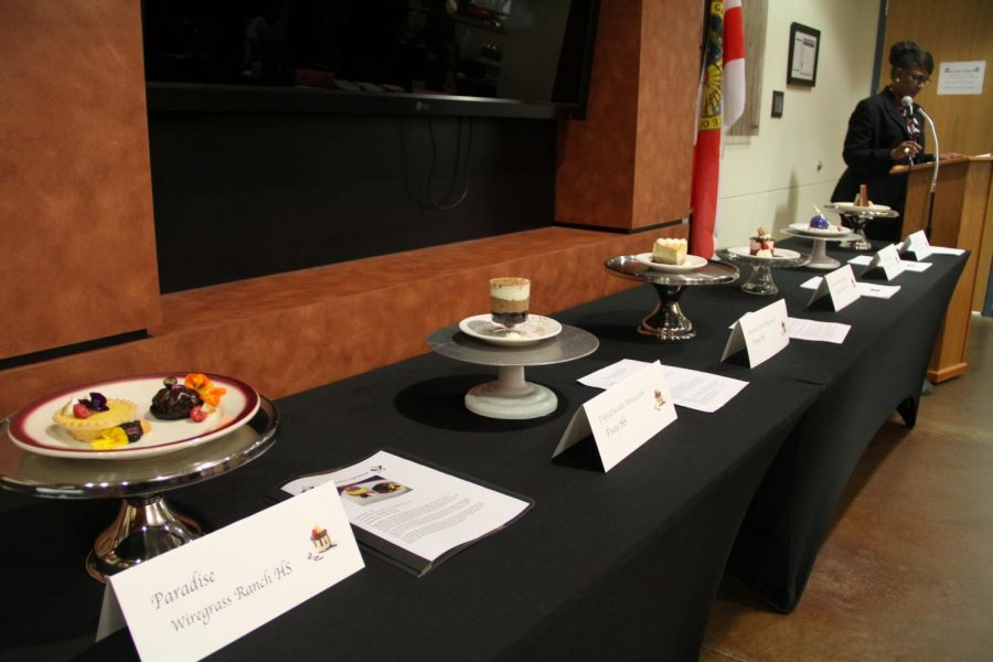 The main table showcasing all 7 desserts from the competition.