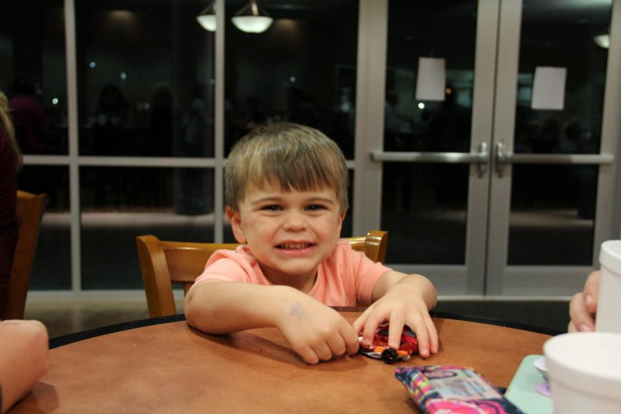 Newspaper Adviser Ashley Swains son Nolan having fun sampling the desserts.