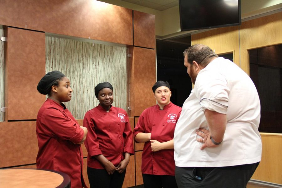 Chef Blythe talking to his team.