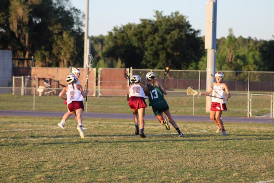 (10) playing defense of sickles player (13) during semi-finals.